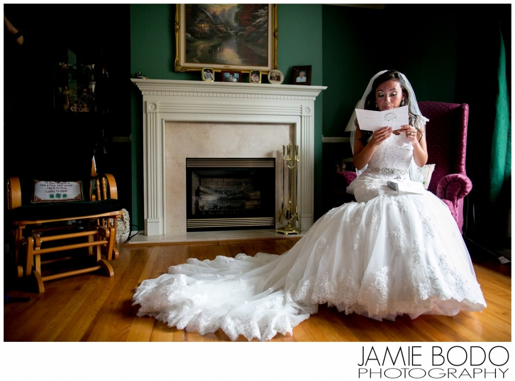 Bride reads emotional letter from groom before wedding ceremony photo
